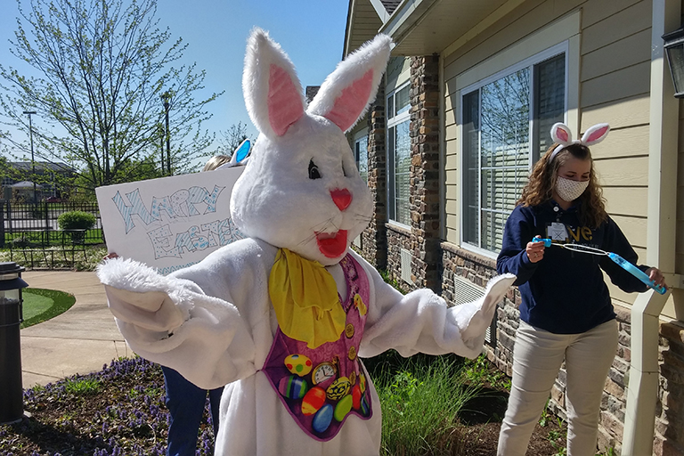 The Easter Bunny dancing with a Crown Hospice volunteer at Life Care Center of Cape Girardeau, Missouri