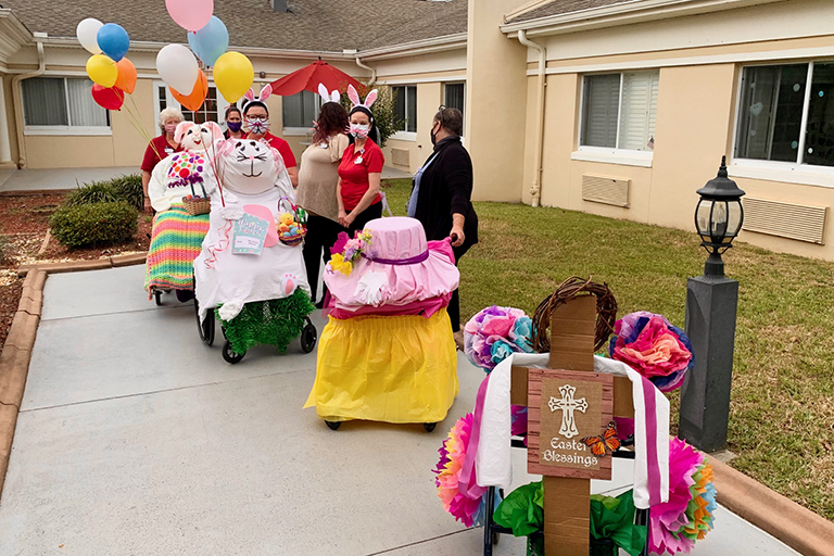Associates at Life Care Center of Citrus County in Lecanto, Florida, with their Easter parade floats