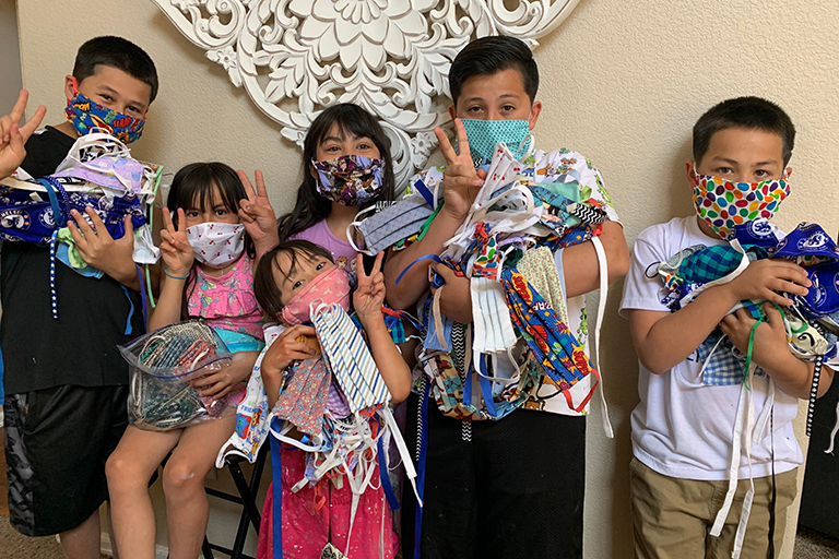 Aja's family rallied to help make and collect masks.