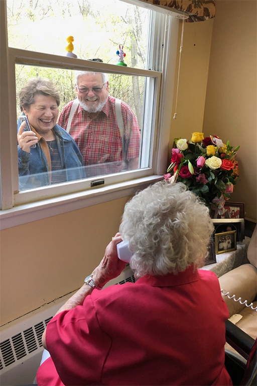 Rosie's son, Bud, and daughter-in-law, Barb, visit at the window after the parade.