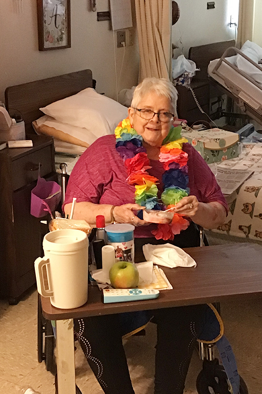 Resident Mary Beavers on Hawaiian Day