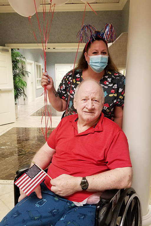 Resident Bruce Ellis with Amie Downing, activity specialist, at Life Care Center of Palm Bay