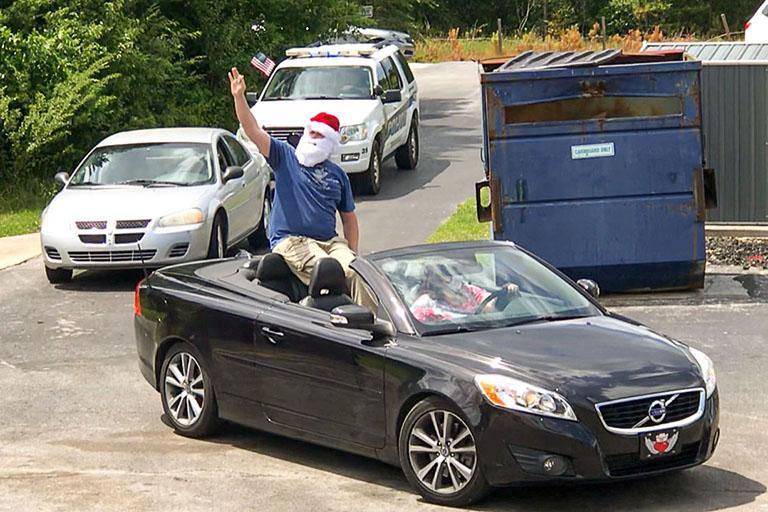 Santa waving near the rear of the parade