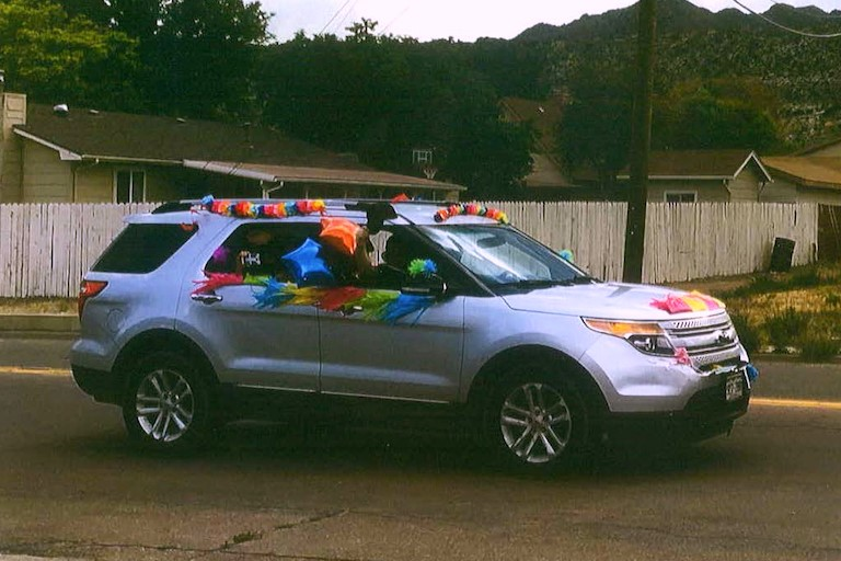 A decorated vehicle drives by.