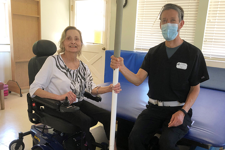 Kathleen with Ben Marean, physical therapist assistant