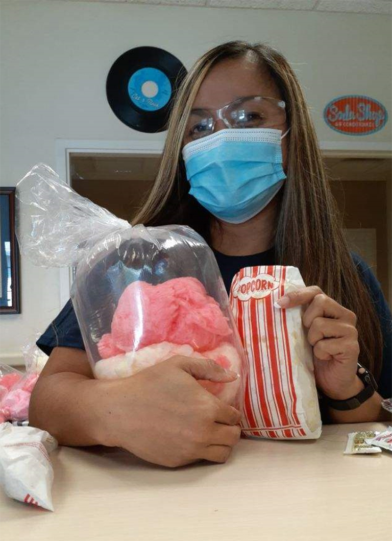 Laverne Fisher, health information manager, with her cotton candy and popcorn