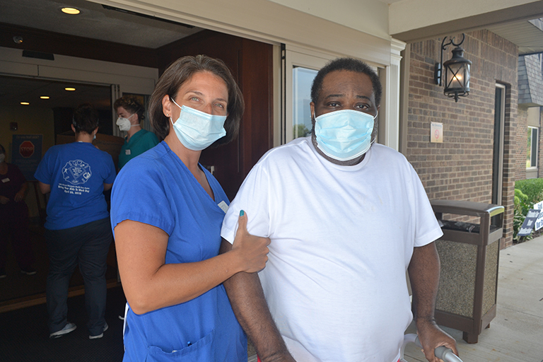 Leonard with Cortney McCarthy, physical therapist assistant