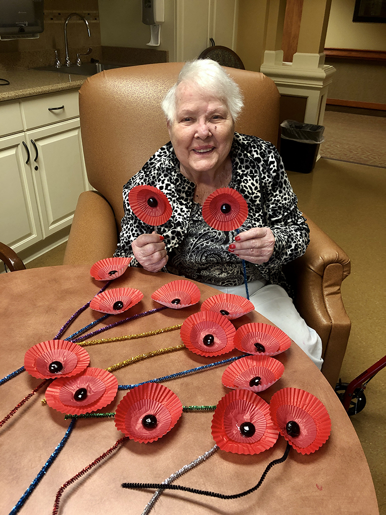 Resident Hattie Myers, a military wife, making poppies at Life Care Center of Blount County