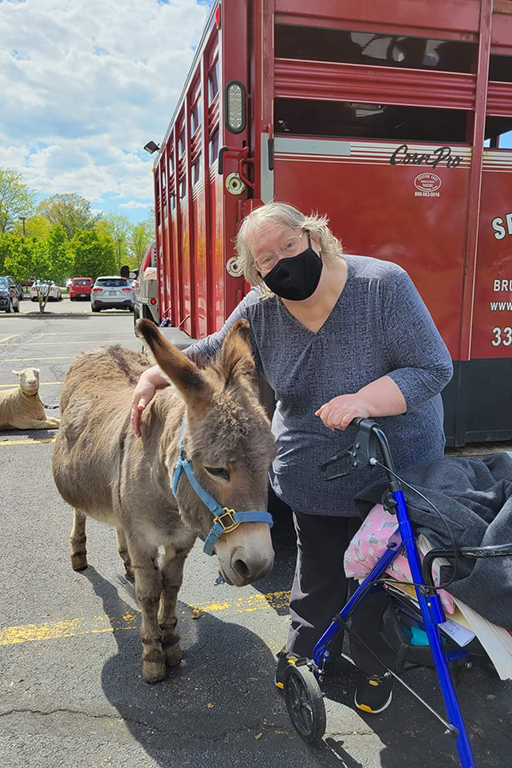 Resident Bonnie Hildebrandt at Life Care Center of Medina at the petting zoo