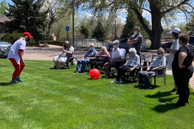 Associates and residents at Valley View Villa enjoying kickball