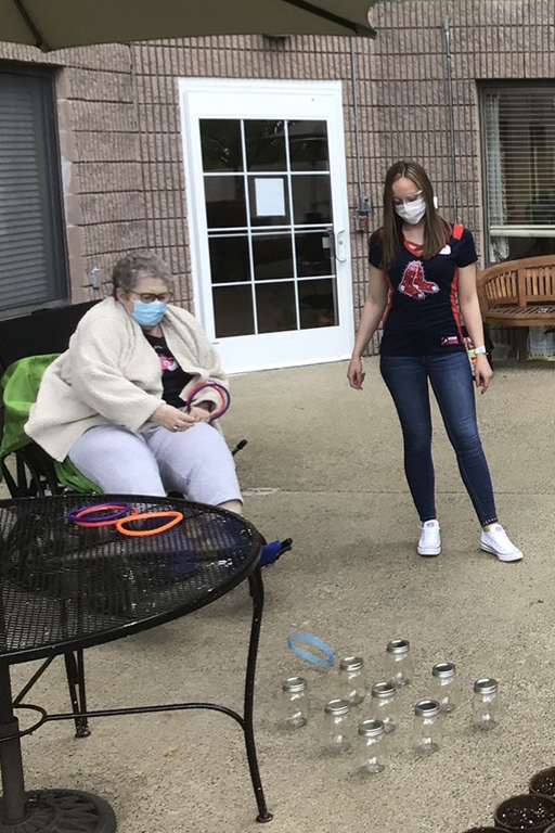 Life Care Center of the North Shore resident Gail McWalters and Casara Lane, activity director, playing a carnival game