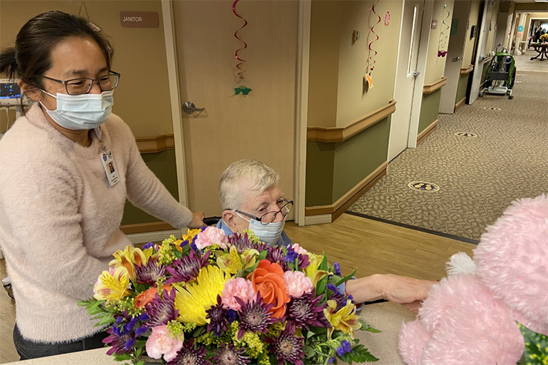 Life Care Center of the Littleton resident Louise Board with Mae Lamn, social services director, during the Easter egg hunt