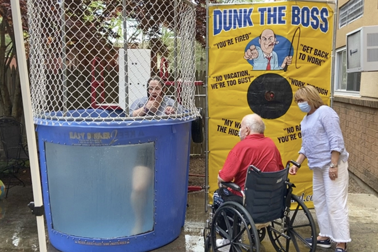 Evergreen House resident Joe Rossi and Jeannie Grant, activities assistant, just after dunking Nat Cushing, executive director