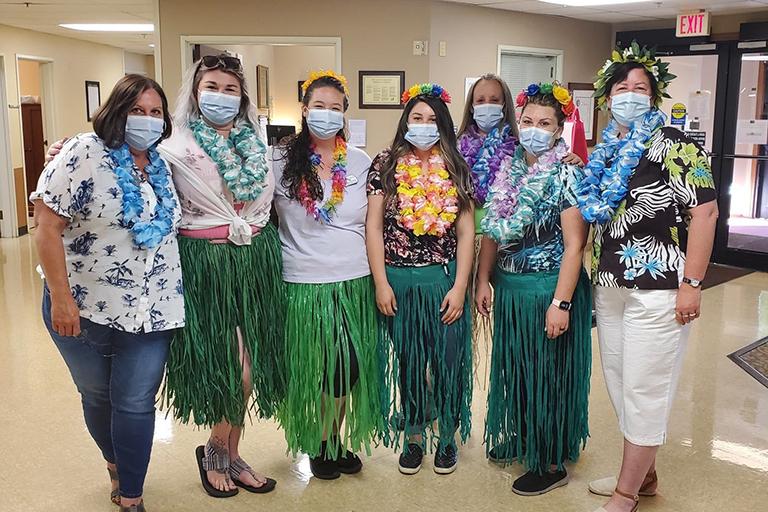 Bridgeview Estates staff members on Hawaiian Day