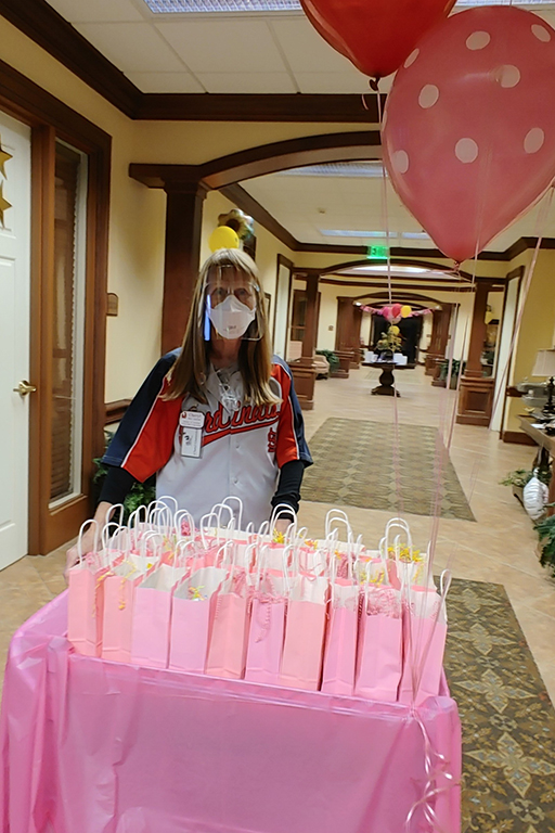 Cheryl Guetersloh, activity director at Cape Girardeau, with the Mother's Day goody bags