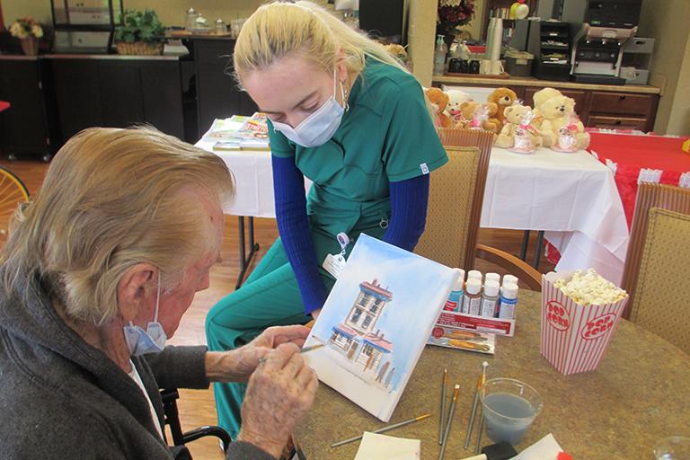 Kirkland resident Gerald Stitt painting with Izabela Ivanova, RN