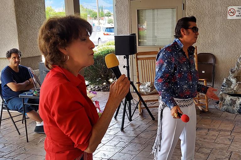 Elvis sings classic American songs to entertain residents.