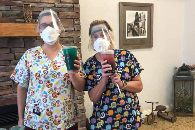 Rochester CNAs Rhonda Knee, left, and Deb Miller, with their teas