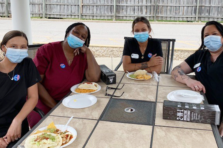 Elyria CNAs (left to right) enjoying Mexican food: Taylor Gibbins, Monique Isom, Lauren Soto and Alicia McElroy