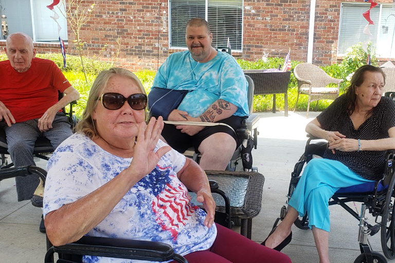Hendersonville resident Carol Fischer waiving with (left to right) in the back: Jack Bell, Terry Bryant and Rosita Appel