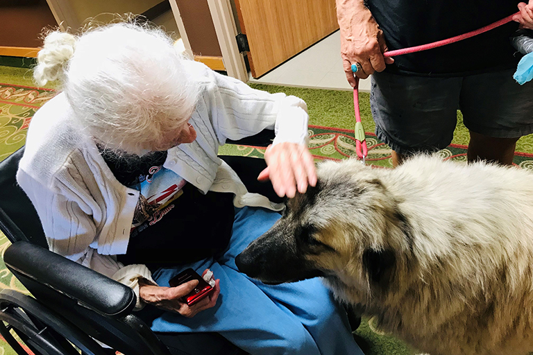 Resident Oma McCains with Stella