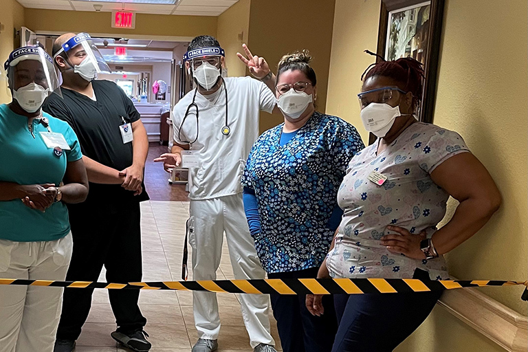 Some of the COVID unit staff (left to right): Rose Mesidor, certified nursing assistant; Alex Hernandez, registered nurse; Alvin Otero, licensed practical nurse; Maria Espinosa, LPN; and Dollmeshia Sanders, CNA