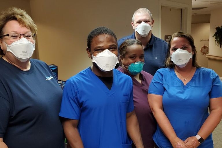 Adetayo Oduwole, LPN at LCC Wichita (center) with (left to right): Kimberly Summers, director of nursing; Lori Stewart, assistant DON; Matthew Stephenson, executive director; and Sytara Lindsay, unit manager
